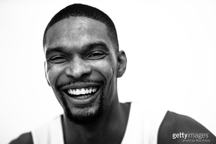 MIAMI, FL - SEPTEMBER 28: (EDITORS NOTE: Image has been converted to black and white.) Chris Bosh #1 of the Miami Heat poses for a portrait during media day at AmericanAirlines Arena on September 28, 2015 in Miami, Florida. (Photo by Rob Foldy/Getty Images) *** Local Caption *** Chris Bosh