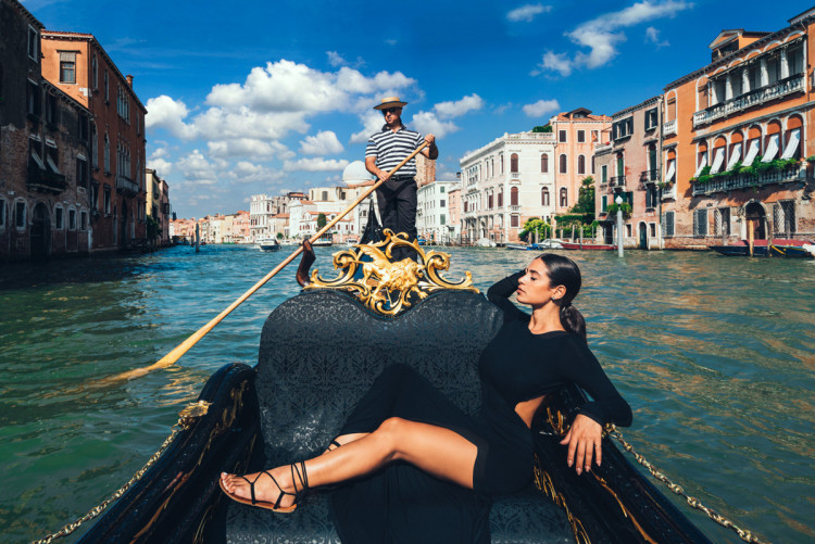 Model on a gondola in Venice, Italy. (Photo by Jeff Lombardo)