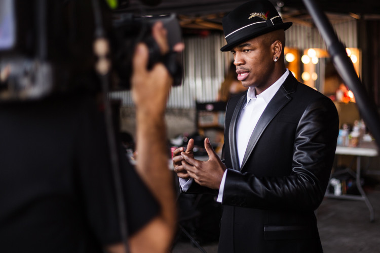 "Ne-Yo being interviewed at his ""Forever Now"" music video shoot. (Photo by Jeff Lombardo)"