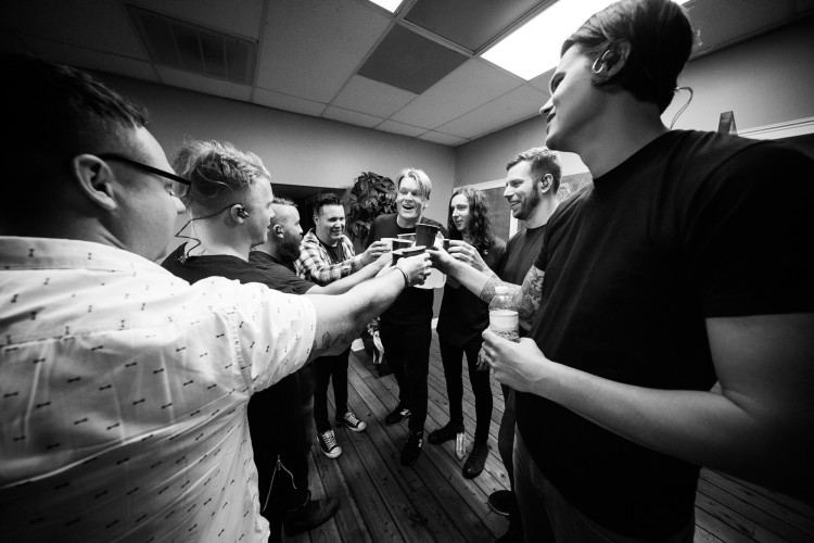 Underoath and Josh Scogin of '68 make a toast before their show on March 16, 2016 at Jannus Live in St. Petersburg, Florida