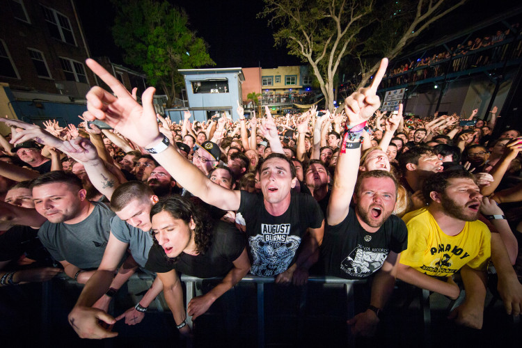 Fans cheer and sing along with Underoath as they perform on March 16, 2016 at Jannus Live in St. Petersburg, Florida